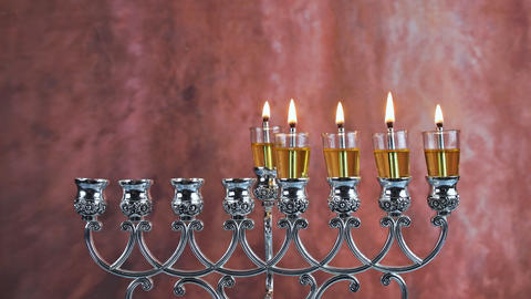 Five Hanukkah candles are burning on light of jewish holiday Fourth day of the Live Action