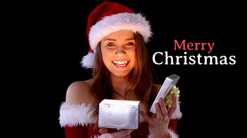 Merry Christmas text and Santa dressed beautiful woman opening gift Animation