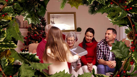 Family Christmas gift ceremony with holly border Animation
