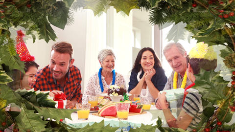 Christmas tree border with family eating dinner Animation