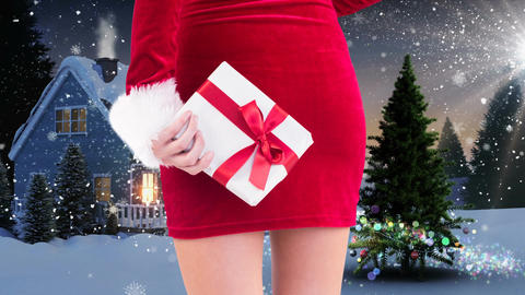 Woman holding gift with Christmas landscape Animation
