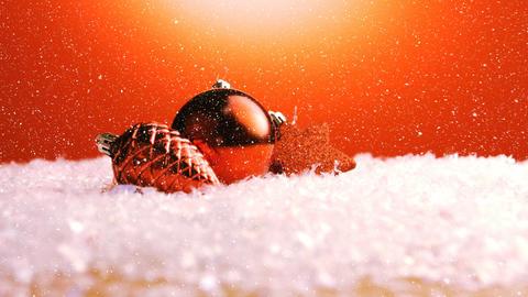 Christmas animation of Christmas ornaments against orange background 4k Animation