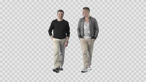 Two friends in casual clothes are walking at the camera, talking, joking smiling Live Action