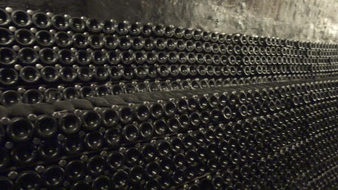 Sparkling wine is aged in bottles in a dark cellar Footage