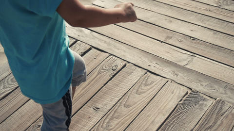 118 boy runs on wooden path Footage