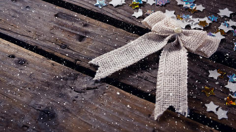 Falling snow with Christmas decoration ribbon Animation