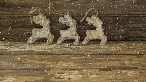 Falling snow with Christmas reindeer decoration on wood Animation