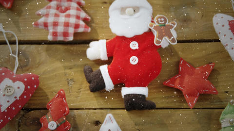 Video composition with falling snow over desk with christmas decorations Animation
