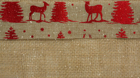 Falling snow with Christmas textile reindeer Animation