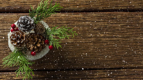 Falling snow with Christmas decoration on wood Animation