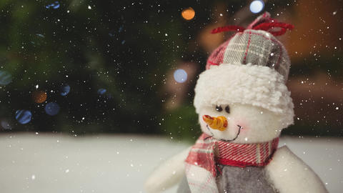 Falling snow with Christmas snowman decoration Animation