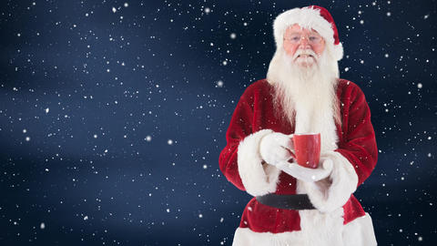 Santa clause holding a hot drink combined with falling snow Animation