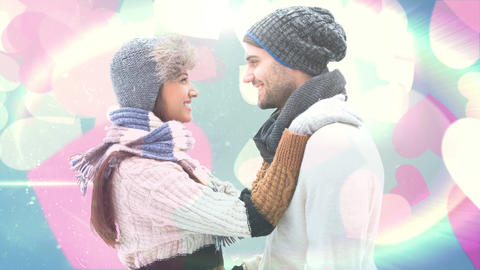 Happy couple in winter clothes smiling at each other Animation