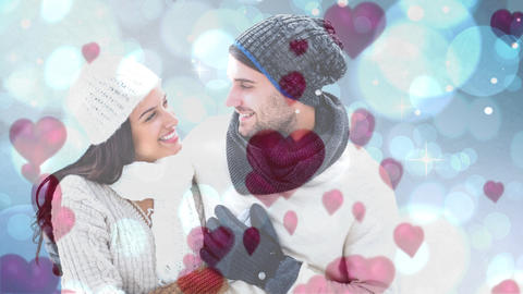 Happy couple looking at each other in cold weather Animation