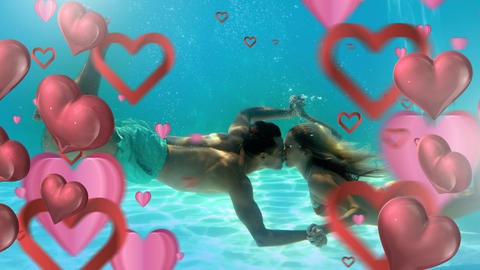 Happy couple kissing underwater with hearts for valentine day Animation