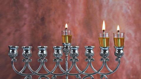 Second day of Hanukkah with burning Hanukkah candles Hanukkiah traditional Live Action