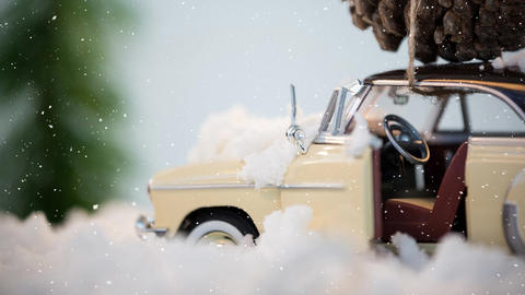 Model car with a fir cone on its roof combined with falling snow Animation