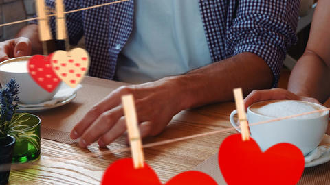 Close up of a couple holding hand at cafe for valentine day Animation