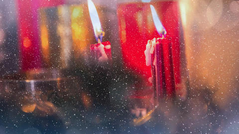 Candles and christmas decoration combined with falling snow Animation