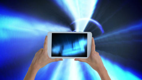 Digital animation of woman holding digital tablet showing illuminated lights Animation
