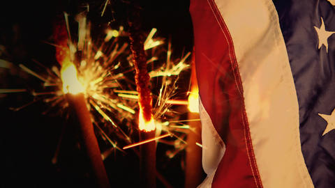 Digital animation of sparklers and american flag at night 4k Animation