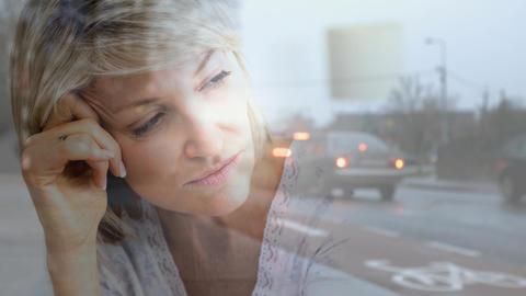 Digital animation of depressed elderly woman against city background 4K Animation