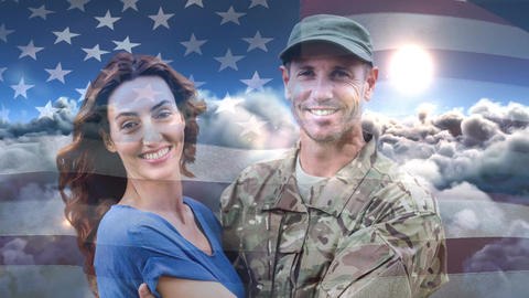 Digital animation of American soldier embracing his wife after home returning against American flag Animation