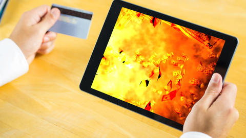 Digital animation of dollar bills falling on the fire flames in digital tablet Animation