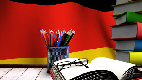 School accessories on a table with German flag floating Animation