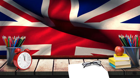 School accessories lying on a table with a british flag in the background Animation