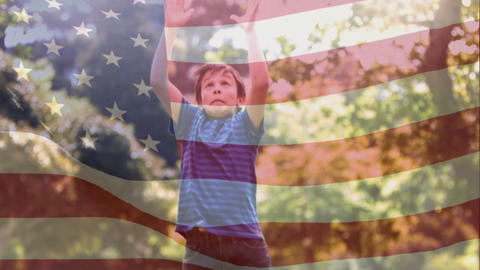 Boy catching American football while American flag waves on the foreground Animation