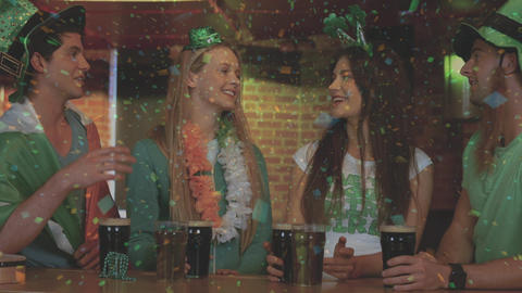 Digital composite of smiling friends with Irish accessory in the bar Animation