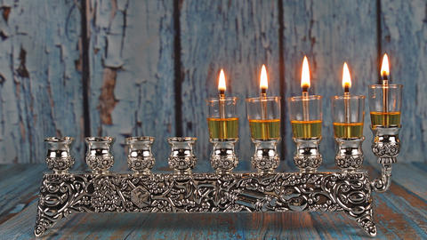 Fourth day of jewish holiday the five Hanukkah candles are burning on light of Live Action