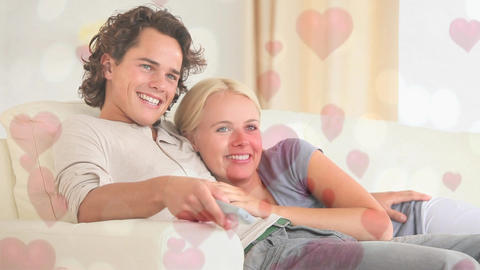 Couple sitting on sofa in living room with hearts Animation