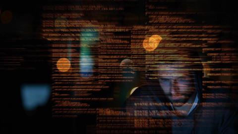 Hacker using computer in dark room Animation