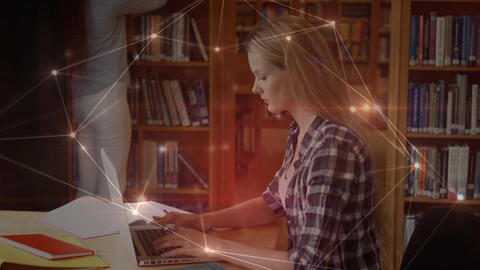 Student using her laptop in library surrounded by data connections Animation