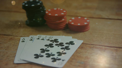 Poker cards and chips on a wooden table Animation