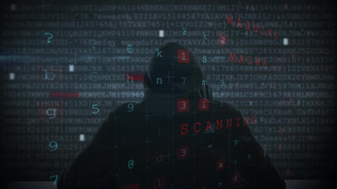 Hacker using computer in dark room with digital code Animation