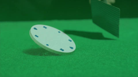 Poker cards and chip on a green poker table Animation