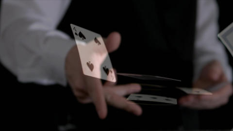 Croupier throwing game cards on a dark background Animation