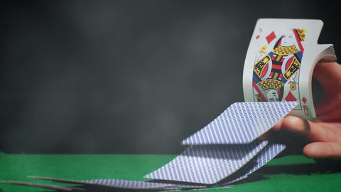 Dealer distributing a cards on green poker table with light effects Animation