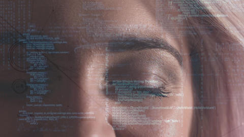 Digital composite of a woman eye looking at the coding system Animation