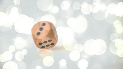 Digital animation of a die rolling on shining backdrop Animation