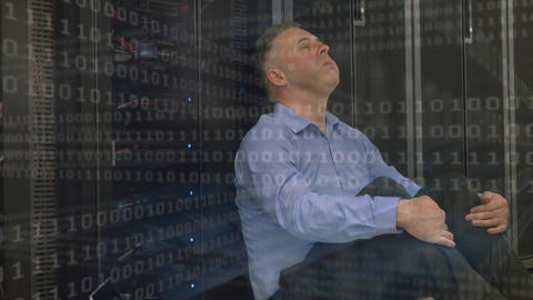 Digital composite of a stressed technician in a server room Animation