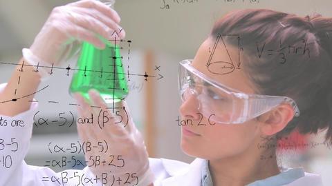 Scientist examining beaker in lab Animation