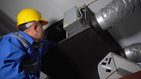 Professional specialist changing air ventilation system filters Live Action