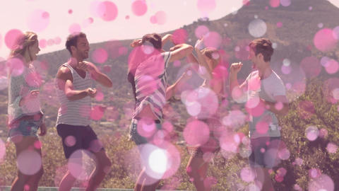 Friends dancing in the mountains surrounded by pimk bubbles Animation