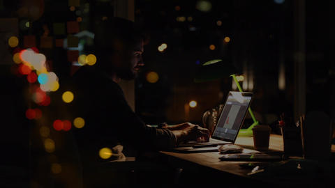 Caucasian man working over laptop by night with bubbble animation Animation