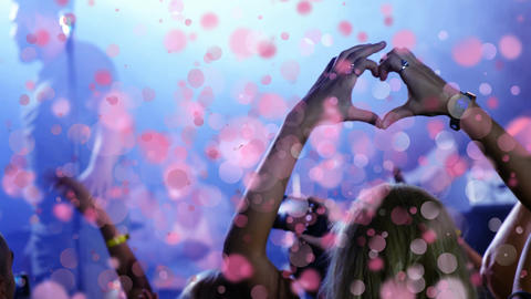 Girl doing heart with her hands to singer at concert with bubble animation Animation