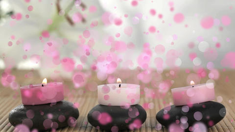 Animation of candles on pebbles surrounded by pink bubbles Animation